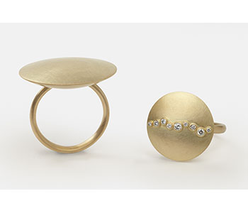 'Meander' rings in 18ct yellow gold set with diamonds