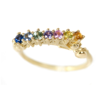 "Frances Wadsworth-Jones - ""Thieves VI"" FlourishRing in18ct yellow gold with rainbow sapphires £1280"