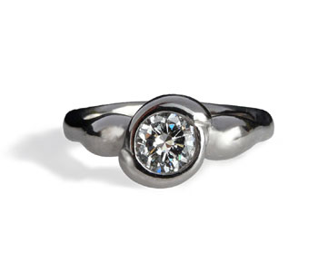 'East Meets West' ring in platinum set with a diamond