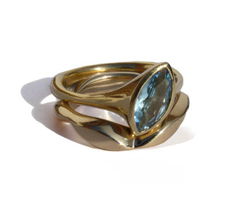 'Flow' rings in 9ct gold set with aquamarine