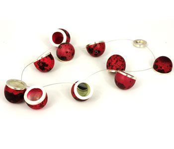 'Void in Red' – necklace in hardened quail eggs, silver, steel cable and mirror