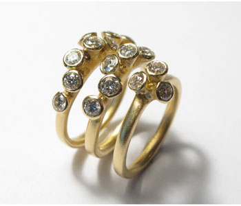 Rings in 18ct yellow gold set with brown diamonds