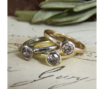 Stacking rings in 18ct golds set with cinnamon old cut diamonds