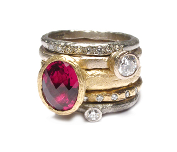 'Strata' set of stacking rings in 18ct white and yellow gold set with garnet and diamonds