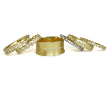 Eternity rings in 18ct yellow and white gold with diamonds