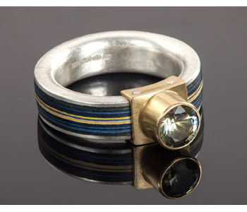 Paper and sapphire ring in gold and silver