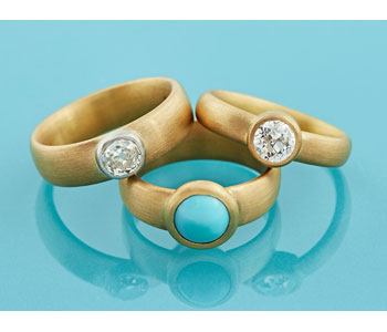Rings in 22ct gold set with antique old cut diamonds and turquoise