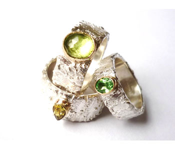'Rivda' – rings in silver and 9ct gold set with peridot, tsavorite, sapphire