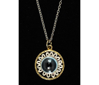 Pendant in silver with gold vermeil detail set with a topaz