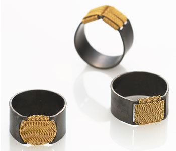 'Roof', 'Terrace', 'Sun' rings by Dorothea Brill in steel with 18ct gold thread