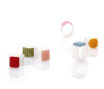 'Roof', 'Terrace', 'Sun' rings in plastic with coloured thread