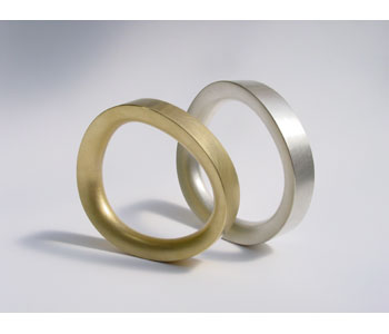 'Not Round' bangles in 18ct gold and silver
