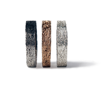 'The Uncanny' series 'Stongi' rings in compressed silver and gold wire. Each ring is made from a single wire more than 30 feet in length