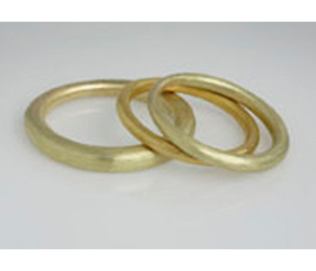 Tapered rings by Jean Scott-Moncrieff in 18ct gold