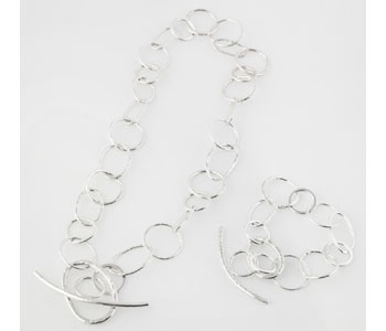 Anchored necklace and bracelet in silver