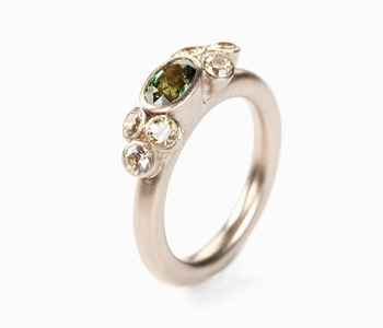 'Seven Bud' ring by Mirri Damer in 18ct white gold set with pale yellow and green sapphires
