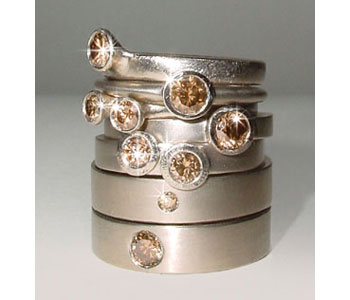 Rings in 18ct white gold set with 'chocolate' diamonds by Diana Porter