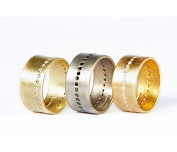 Rings by Natalie Jane Harris in 18ct yeRings in 18ct yellow and white gold set with black and white diamonds