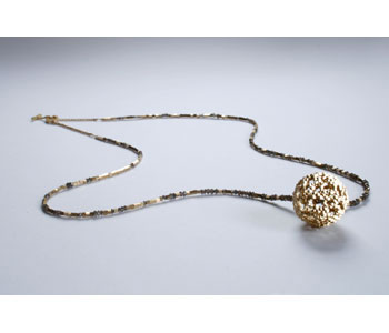 Gold sphere and diamond necklace