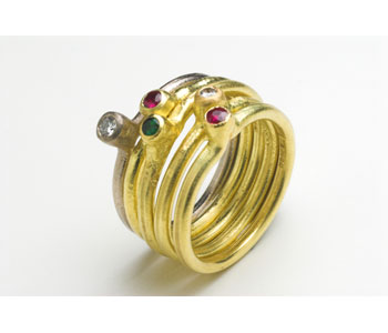 'Fused' rings by Michael Carberry in 18ct gold set with rubies, diamonds and emerald