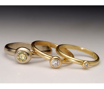 'Pebble' rings by Malcolm Morris in 18ct yellow and white gold set with diamonds