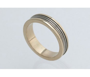 'Spin' ring by Shona Carnegie in 18ct white and yellow gold