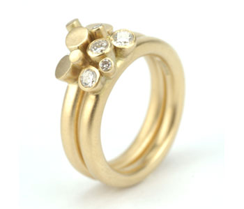 'Bud' rings in 18ct yellow gold set with diamonds