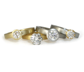 Four rings in 18ct yellow and white gold with diamonds