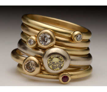 'Pebble' rings in 18ct yellow and white gold set with diamonds and ruby
