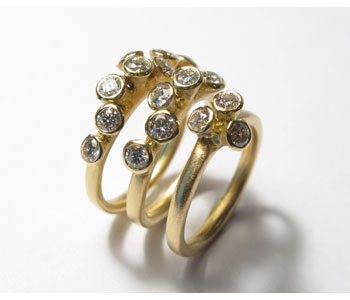 Rings in 18ct yellow gold set with diamonds