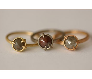 Claw rings in 18ct yellow, white and rose gold with precious stones