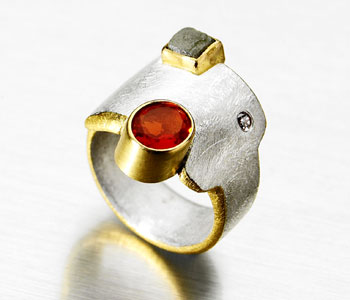 Ring in silver, 22ct gold fire opal and Ring in silver and 22ct gold set with fire opal and rough diamond