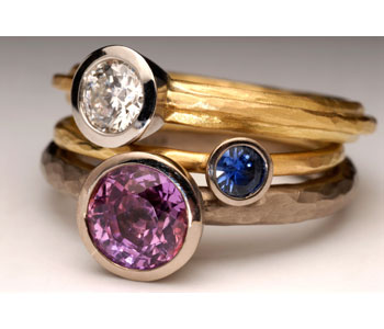 'Cup' rings by in 18ct white and yellow gold with diamond and sapphire