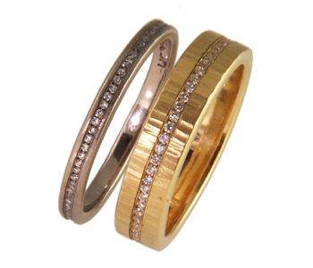Eternity rings in 18ct yellow and white gold channel set with diamonds