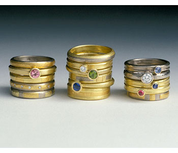 Rings by Catherine Mannheim in 18ct white and yellow gold set with precious stones