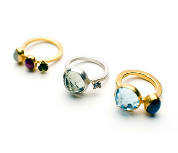'Indian Summer' rings from left to right: gold plated silver ring set with moonstone, ruby and tourmaline; 9ct gold and silver ring set with green amethyst and white sapphire; gold plated silver ring set with blue topaz and labradorite